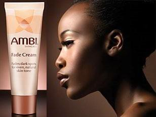 african american woman using a fade cream